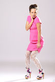 Pin-up girl in pink dress Stock Images