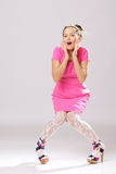 Pin-up girl in pink dress Royalty Free Stock Image