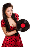 Pin-up girl with a plate. Happy pin-up girl with a plate Royalty Free Stock Images