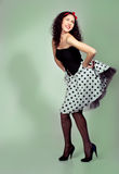 Pin up girl posing over white background stock images