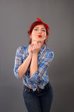 Pin up girl poutig her lips for a kiss Royalty Free Stock Photography