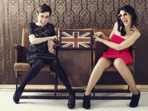 Pin up girl quarreling for a cosmetic bag full of makeup Stock Photography