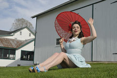 Pin up girl with a red perasol Royalty Free Stock Photography