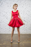 Pin up Girl in red silk dress Royalty Free Stock Photography