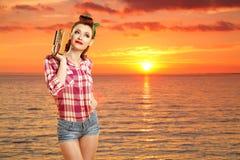 Pin-up girl at the resort. Stock Photos