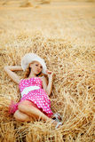 Pin-up girl resting in haystack Royalty Free Stock Photos