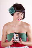 Pin-up girl with retro camera Stock Image
