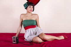 Pin-up girl with retro camera Royalty Free Stock Images