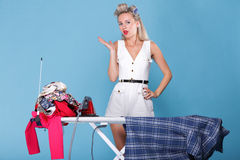 Pin up girl retro style portrait woman ironing Stock Images