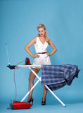 Pin up girl retro style portrait woman ironing Royalty Free Stock Photos
