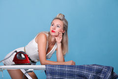 Pin up girl retro style portrait woman ironing Stock Photos