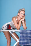 Pin up girl retro style portrait woman ironing Stock Photography