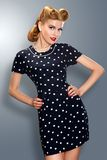 Pin-up girl in retro vintage dress posing royalty free stock photography