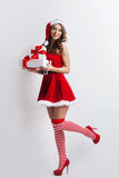 Pin-up girl in santa claus clothes Royalty Free Stock Image