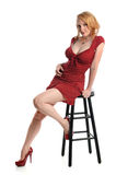 Pin Up Girl Seated on Stool Stock Photos