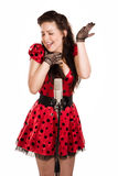 Pin-up girl singing a song. Pin-up girl with a microphone on stage singing a song royalty free stock photos