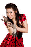 Pin-up girl singing a song. Pin-up girl with a microphone on stage singing a song Stock Images
