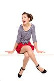 Pin-up girl sitting Stock Photography