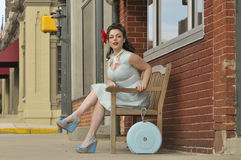 Pin up girl sitting on a bench Stock Photos