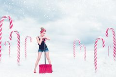 Pin-up girl with snow shovel stock images