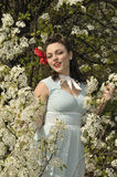 Pin up girl in the spring time with dogwood tree Stock Image