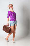 Pin up girl standing with bag Royalty Free Stock Photography