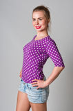Pin up girl standing and smiling portrait Royalty Free Stock Image
