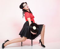 Pin-up girl style retro woman analogue record Royalty Free Stock Image