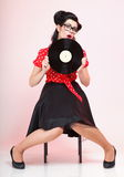 Pin-up girl style retro woman analogue record Royalty Free Stock Photography