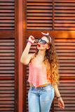 Pin-up girl in sunglasses licking lollipop. Stock Image
