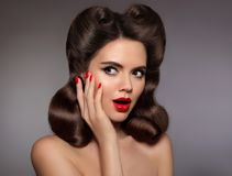 Pin up girl surprised with red lips makeup and manicured nails, Stock Photos