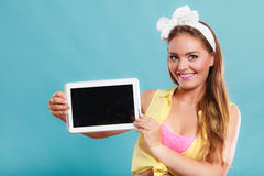 Pin up girl with tablet. Blank screen copyspace. Stock Photos