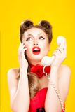 Pin-up girl talking on retro telephone Royalty Free Stock Image