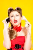 Pin-up girl talking on retro telephone Stock Photography