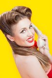 Pin-up girl talking on retro telephone Royalty Free Stock Photos
