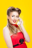 Pin-up girl talking on retro telephone Royalty Free Stock Photo