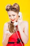 Pin-up girl talking on retro telephone Stock Photos