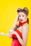 Pin-up girl talking on retro telephone Royalty Free Stock Photos
