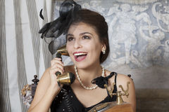 Pin Up Girl Talking on Telephone. Pin-Up Style Young Woman Talking on Telephone royalty free stock photos