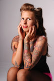 Pin-up girl with tattoos. Stock Images