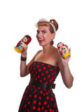 Pin-up girl with two Matryoshka dolls. Against a white background Stock Photos