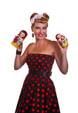 Pin-up girl with two Matryoshka dolls. Against a white background Stock Images