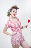 Pin-up girl with valentines heart royalty free stock photography