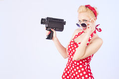 Pin-up girl with vintage camera Royalty Free Stock Photography