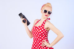 Pin-up girl with vintage camera Royalty Free Stock Image