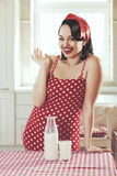 Pin up girl. Vintage retro photo of pin up girl in the kitchen at house Stock Photos