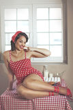 Pin up girl. Vintage retro photo of pin up girl in the kitchen at house stock images
