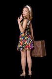 Pin up girl with vintage suitcase waving hand Stock Photo