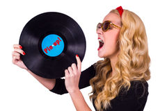 Pin-up girl with vinyl. Isolated Pin-up girl touching vinyl LP with tongue Royalty Free Stock Photography