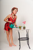 Pin up girl watering the flowers Stock Photos